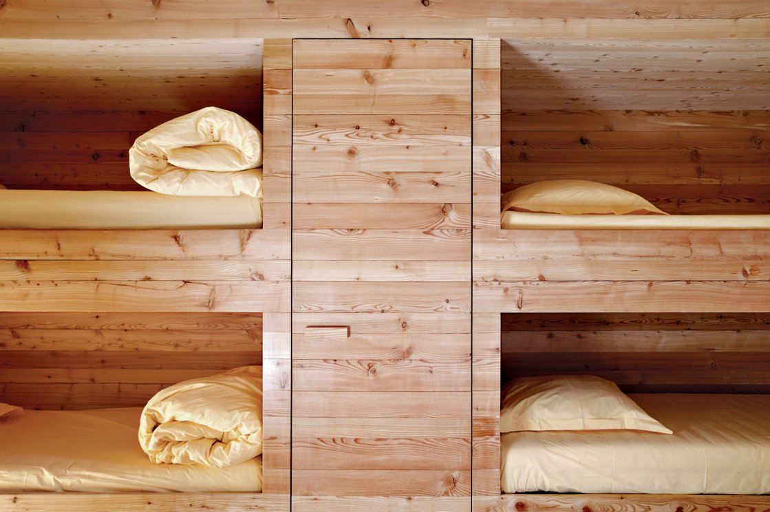 The entire Wooden Cabin—including the sleeping cubbies, shown here—is clad in locally sourced larch, which over time will turn gray then black. Read the full story here. First-Class Cabins - Photo 5 of 9