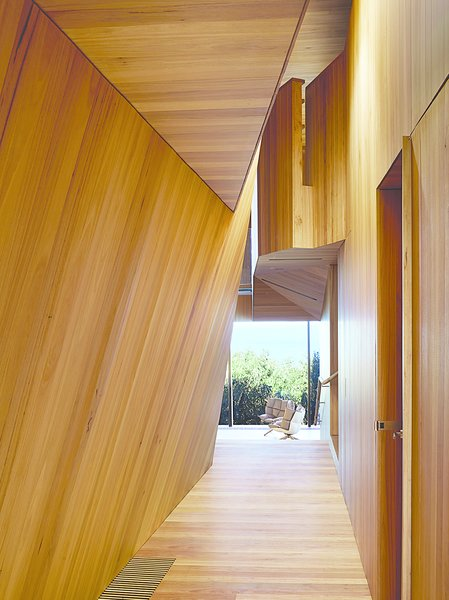 The house that architect John Wardle designed for a couple in coastal Fairhaven, Australia, twists and bends to comply with local laws that prevent buildings from disrupting the ridgeline views from the Great Ocean Road.