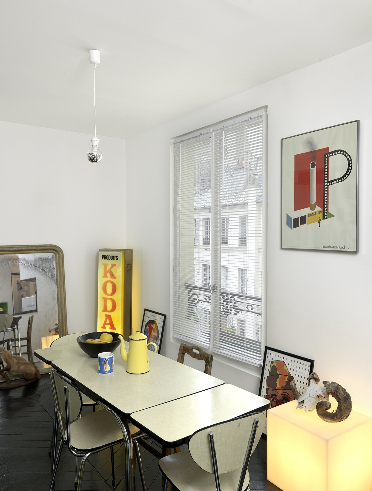 A simple poster with bold colors adds to the industrial character of this Paris abode. Photo by Céline Clanet.  Photo 9 of 11 in 10 Dreamy Parisian Homes from Shelf Life