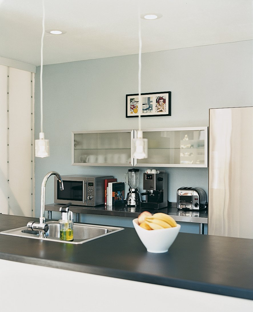 The Viking range and Bosch refrigerator in the kitchen are paired with Ikea lights and cabinets. Affordable Modern House Built with Sheer Determination - Photo 5 of 6