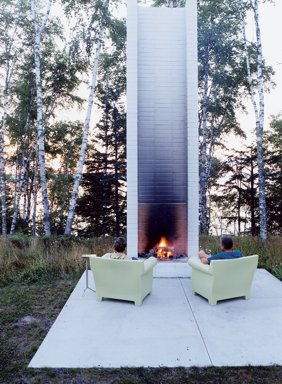 """Philippe Starck's outdoor chairs for Kartell provide cozy fireside seating. These and the sofa version were selected by Salmela. """"They're very much an art form,"""" he says. Tagged: Outdoor, Small Patio, Porch, Deck, and Concrete Patio, Porch, Deck.  Photo 2 of 10 in Off the Beaten Path"""