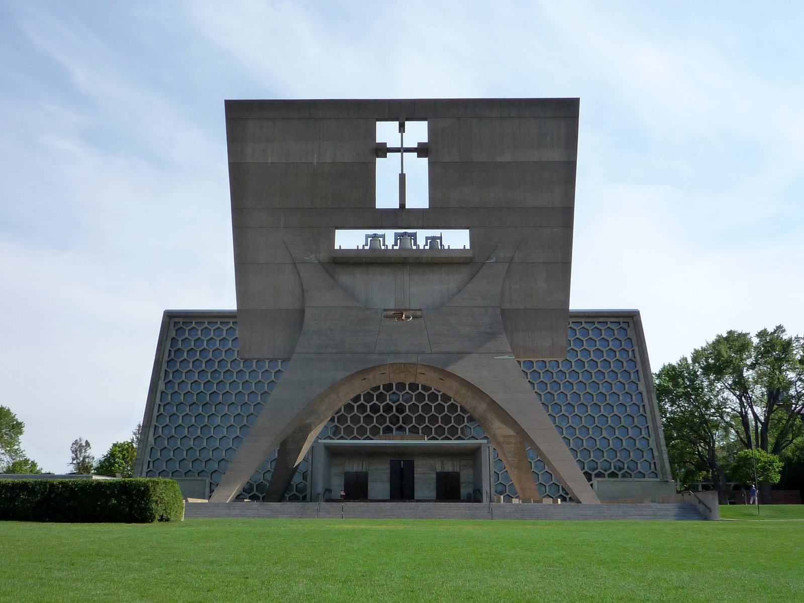 Marcel Breuer, St. John's Abbey (1961)  Designed by a Bauhaus icon, the modernist Minnesota church greets the faithful with a bell tower perched upon a curvaceous concrete stand. Breuer follows up a strong introduction with the church itself, boasting a massive wall of hexagonal stained glass and bold concrete tresses.  Photo courtesy Wikimedia Commons 10 Inspiring Modern Churches - Photo 3 of 10