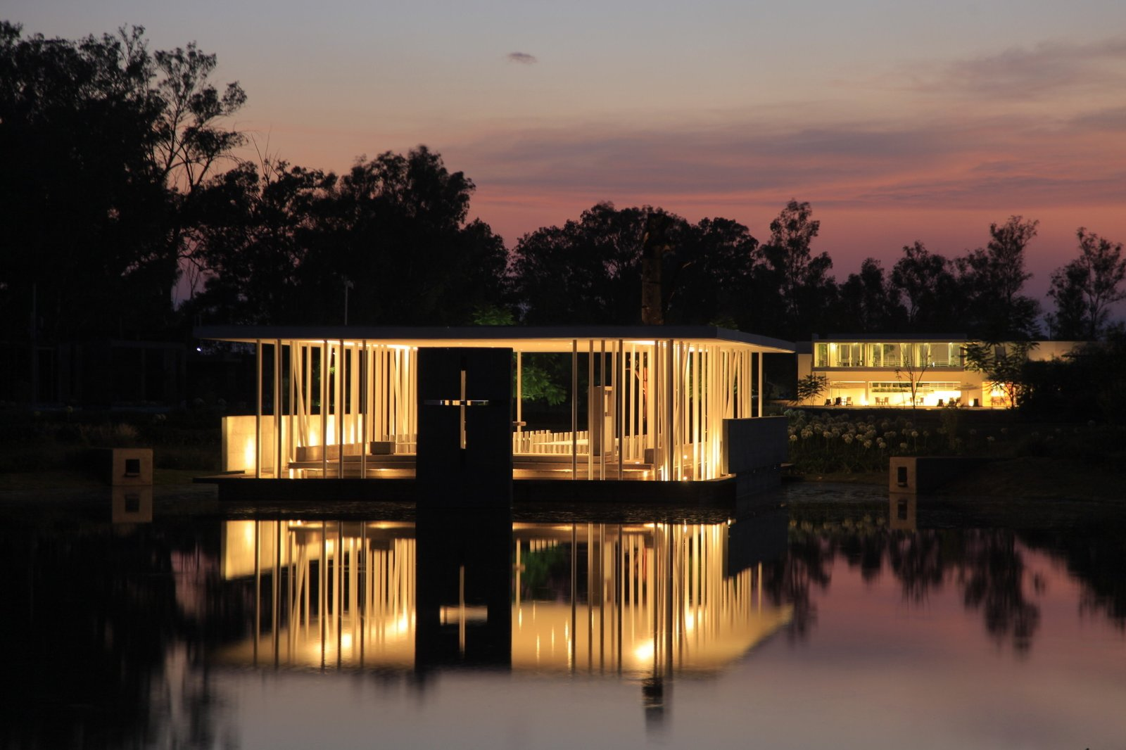Di Vece Arquitectos, Capilla del Lago (2010)   Working on a slightly smaller scale, this waterfront, open-air structure in Michoacán, Mexico, boasts supports that function like a cluster of votives at night.  Photo courtesy Di Vece Arquitectos  Photo 9 of 10 in 10 Inspiring Modern Churches