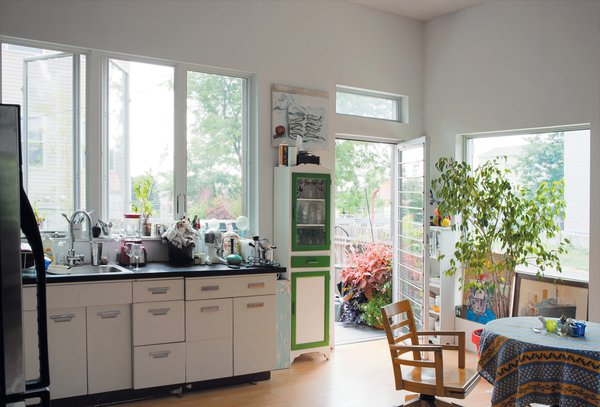 The salvaged 1950s-era kitchen cabinets by Republic Steel, covered with a new Formica countertop, represent both a significant cost savings and Carpenter's commitment to sustainability. The kitchen opens onto a 72-square-foot deck that offers a view of the Statue of Liberty.