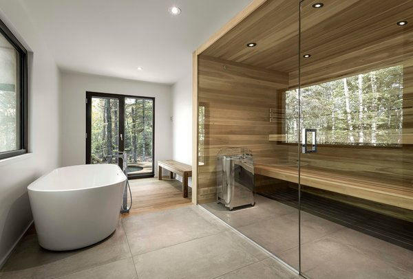 A sauna is an optional feature. Cedar and concrete create a recurring visual theme from the exterior to the interior. Photo 4 of Spahaus modern home