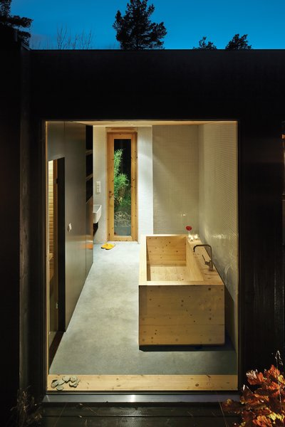 Sævik designed the wood tub in the bathroom, which features an adjacent sauna. The Inxx A5 faucet is by Mora.
