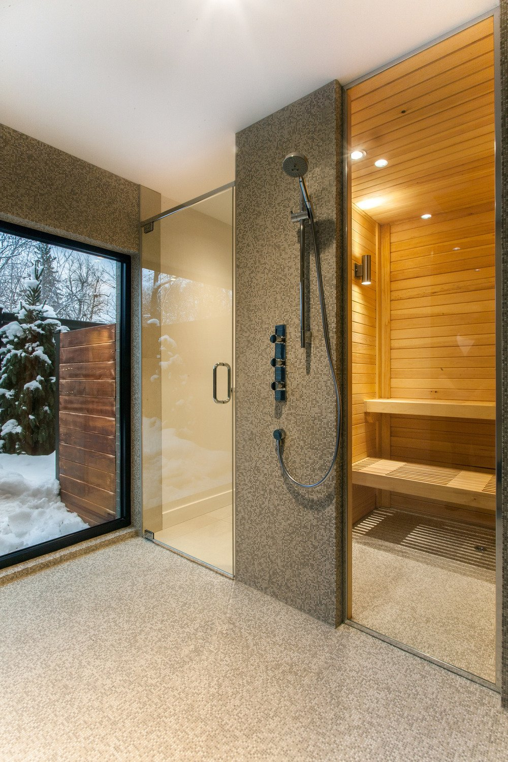 The renovated house is outfitted with a sauna.  Photo 9 of 10 in 10 Sterling Saunas in Modern Homes from Near Montreal, a 1950s House Gets a Modern Makeover