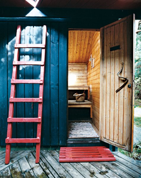 """The sauna door handle is a simple piece of driftwood. """"One principle rule I followed,"""" says Kiehl, """"was: Don't build on outdoor space if it can work as outdoor living space. Norwegian summers are short. We want to be outdoors as much as possible."""""""