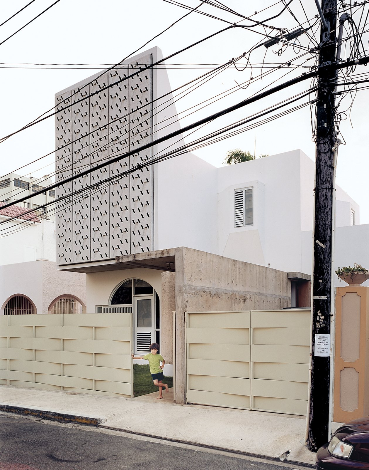 The perforated concrete panels on the façade of Casa Delpin.  Photo 1 of 8 in San Juan, PR