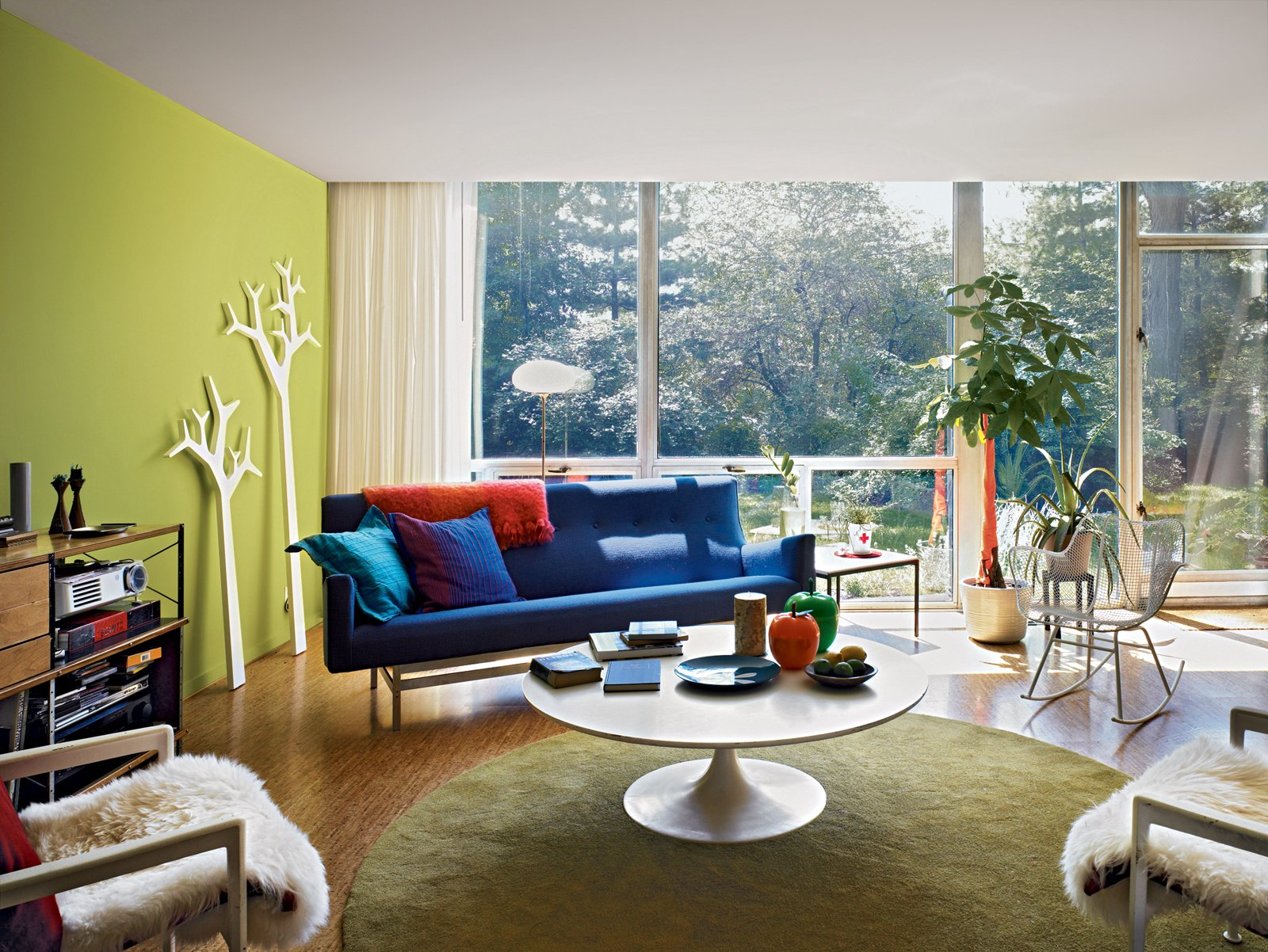 In the living room, a pair of Tree coat hangers by Michael Young and Katrin Petursdottir for Swedese contrast with the live foliage outside.  Midcentury Homes by Dwell from Mies van der Rohe, Lafayette Park