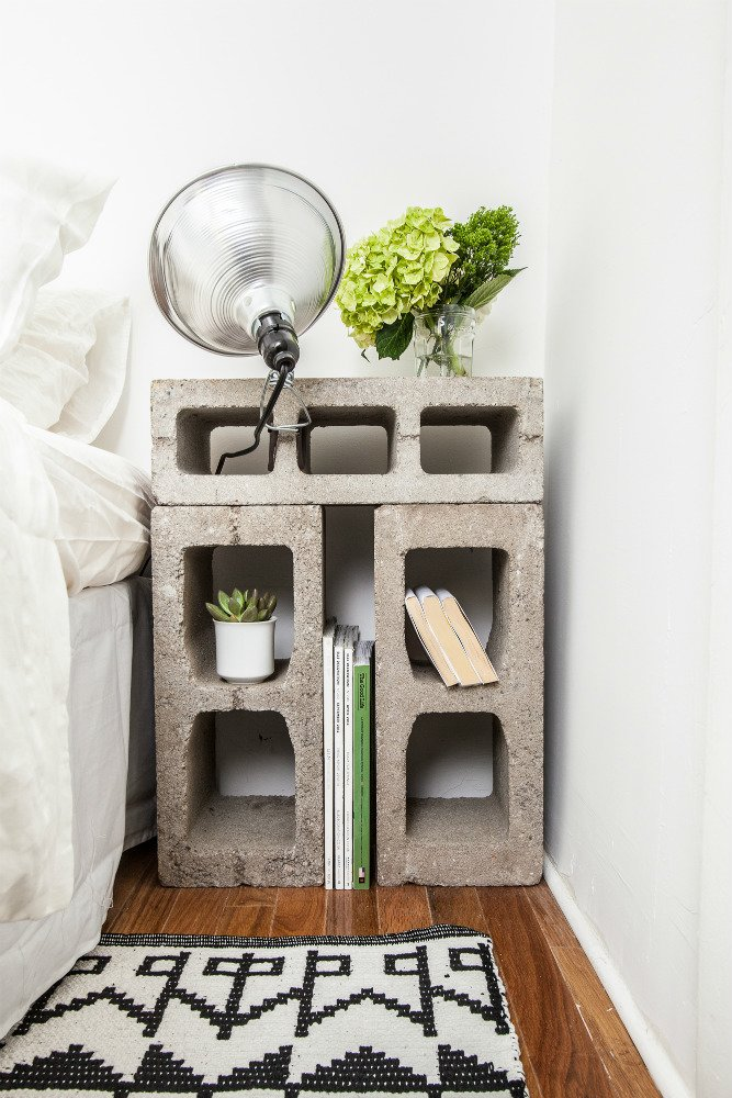 The nightstands were fashioned from concrete blocks that were rescued from the street outside the building. Photo by Alan Gastelum. A Gut Renovation Transforms a Tiny Manhattan Apartment - Photo 6 of 8
