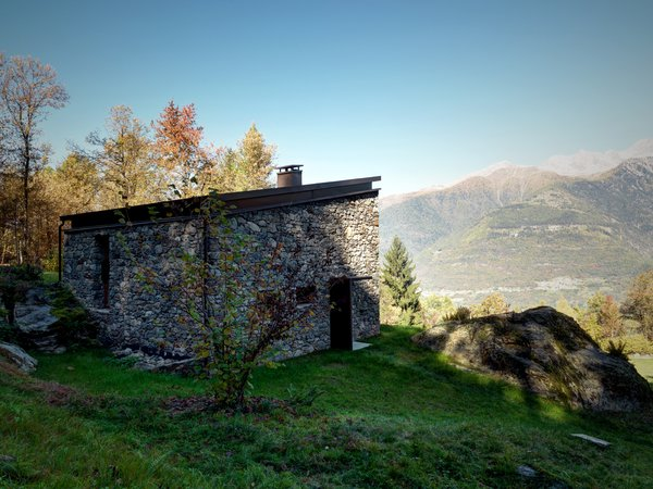 "Architect Alfredo Vanotti sourced the home's stone exterior from the woods behind the property. ""I believe that mountain architecture is an emblematic example of sustainable architecture,"" he says."