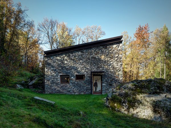 Reinforced concrete stands behind the stone facade to provide insulation. Vanotti wanted to focus this project on the simple materials of concrete, natural larch, iron, and wood.