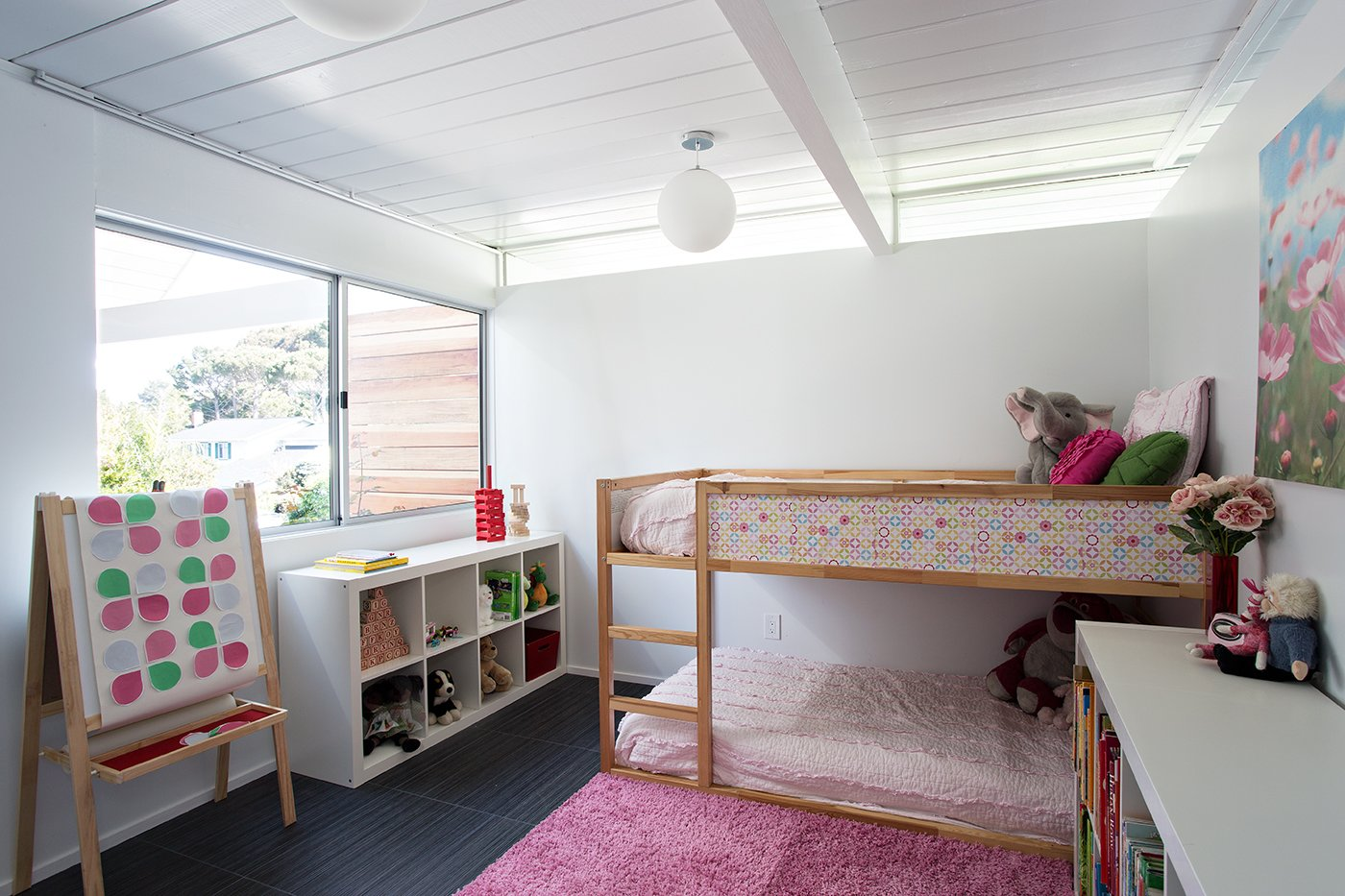 A girl's bedroom features a ceiling with wainscoting—an impactful way to enhance the space. Photo by Mariko Reed. Tagged: Kids Room and Bedroom.  Photo 3 of 7 in Eichler Remodel in Burlingame, California