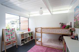 Eichler Remodel in Burlingame, California - Photo 3 of 7 - A girl's bedroom features a ceiling with wainscoting—an impactful way to enhance the space. Photo by Mariko Reed.