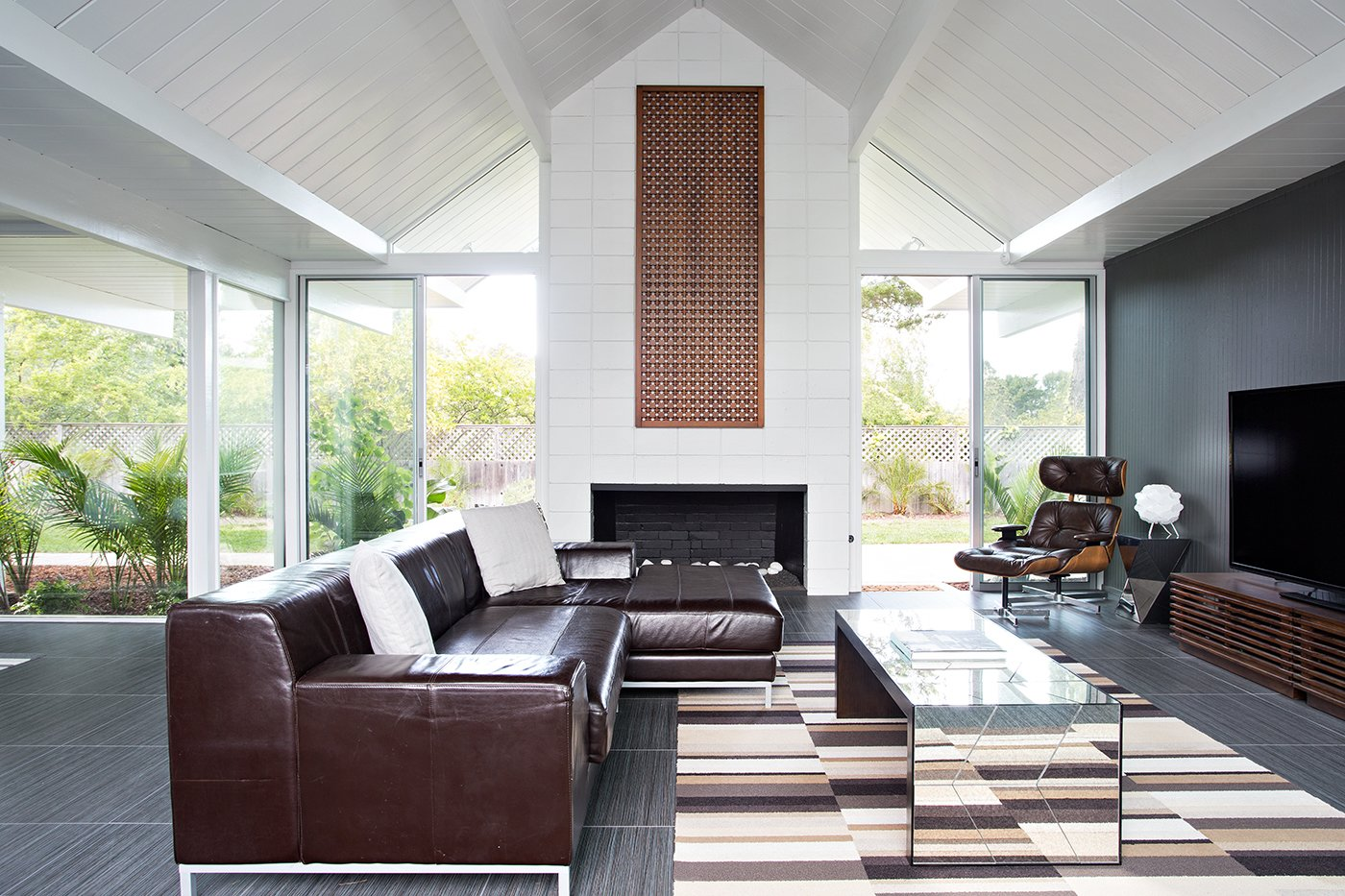 The combination of high ceilings and a cathedral-style design add character to the kitchen area. Photo by Mariko Reed. Tagged: Living Room, Sofa, and Recliner.  Modern Eichler Renovations by Allie Weiss from Eichler Remodel in Burlingame, California