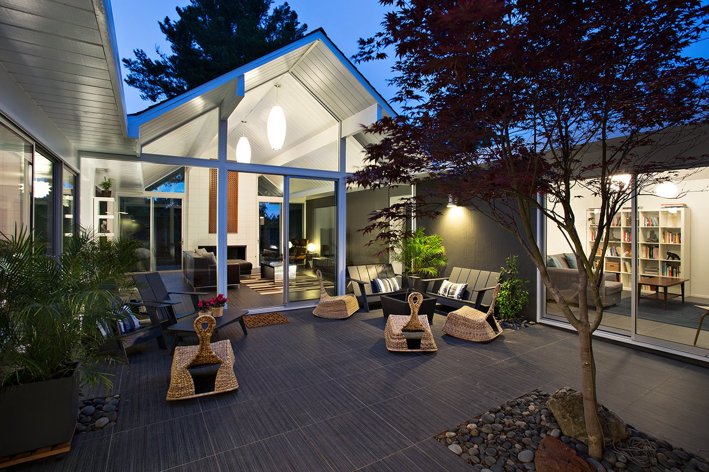 The living area opens beautifully into the outdoor area, which is a key design element of Eichler homes. Photo by Mariko Reed. Tagged: Exterior, House, and Mid-Century Building Type.  Photo 7 of 7 in Eichler Remodel in Burlingame, California
