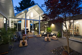Eichler Remodel in Burlingame, California - Photo 7 of 7 - The living area opens beautifully into the outdoor area, which is a key design element of Eichler homes. Photo by Mariko Reed.