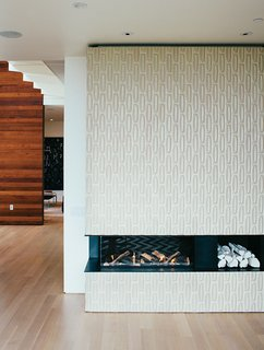 A Home with Eclectic Style Looks Just Right - Photo 9 of 19 - Tiles from Heath Ceramics surround the Ortal Clear 130LS fireplace. The white ceramic logs are by Klein Reid; the floor is oak.
