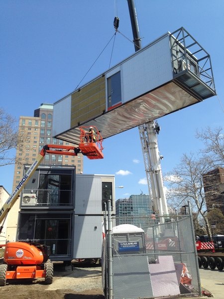 """7 Inspiring Solutions For Disaster Relief Housing - Photo 21 of 26 - """"It was erected in one and a half days; the modulars went up in one day, the stairs went up the next,"""" Garrison says. The construction process can be viewed in a video on Garrison's blog."""