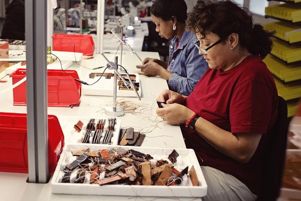 A single watch band passes through the hands of nearly a dozen people during the manufacturing process.