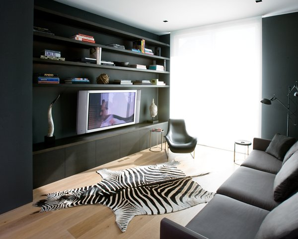 The media room is all about relaxing, whether in the nine-foot-long, extra-deep sofa from Minotti or the lounge chair from B&B Italia.Photo by <br><br>Ben Mayorga Photography