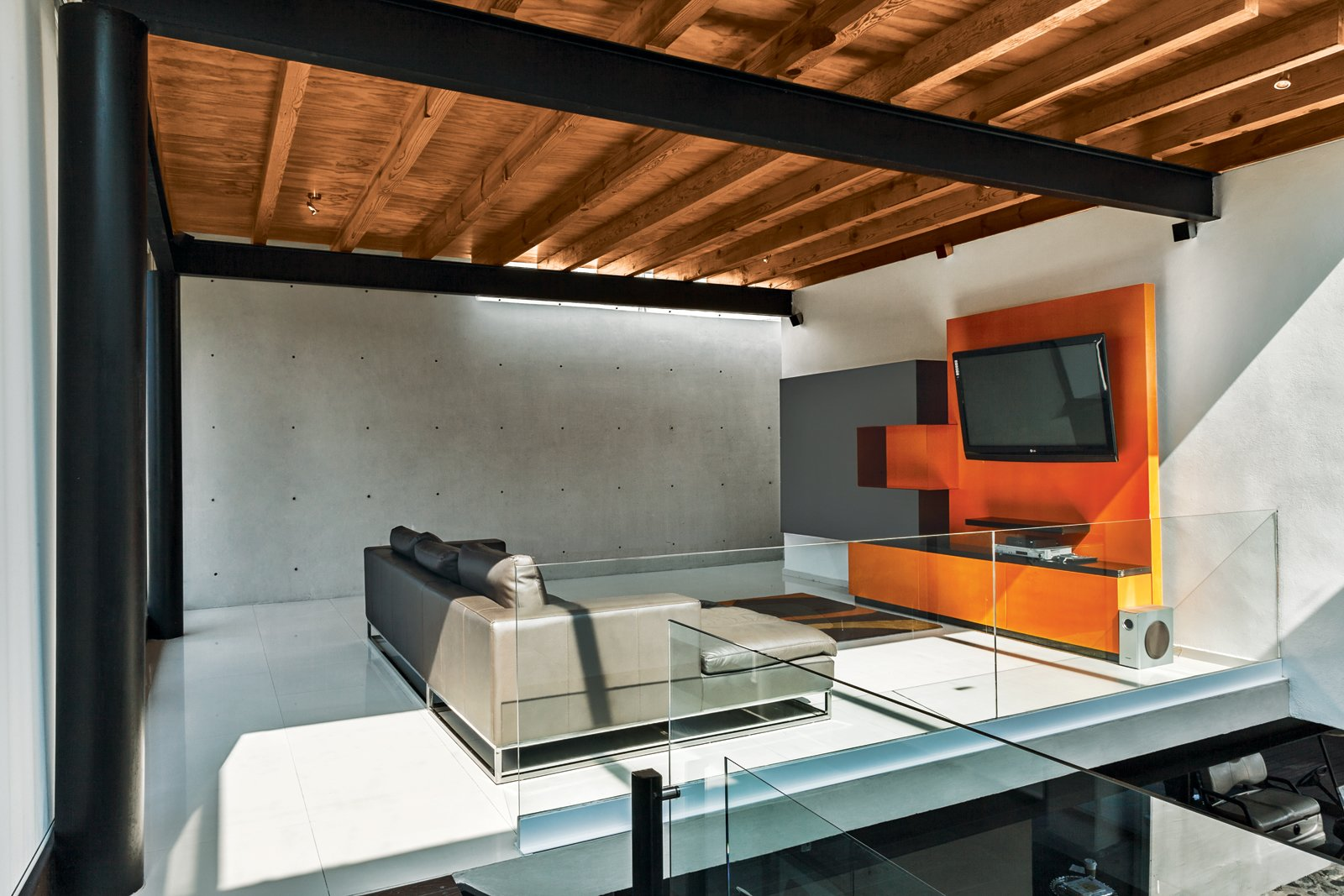 Roche Bobois's Agami sofa anchors the media room.  Photo 4 of 7 in An Affordable High-Design Vacation Home in Mexico