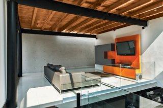 Roche Bobois's Agami sofa anchors the media room.