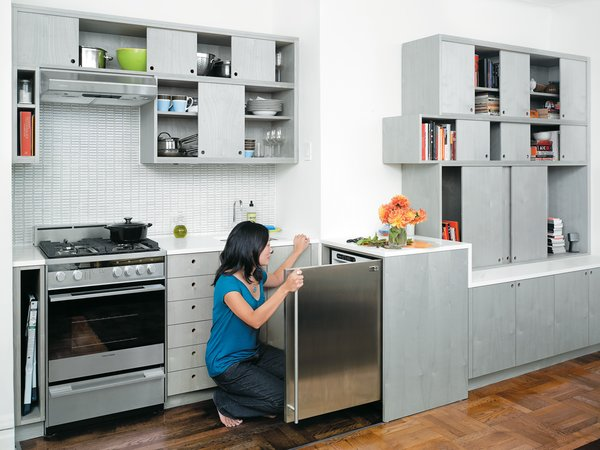 Perhaps Workstead's most liberating move was to flip the position of the refrigerator from the galley wall to an adjacent space outside the kitchen proper. In one fell swoop, this strategy dramatically expanded cabinet space and added a working countertop.