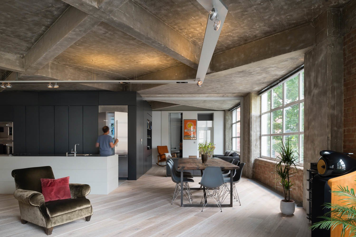 The renovation was designed to preserve and call attention to the angular pattern of the crisscrossing concrete ceiling beams. Photo by Jim Stephenson. Tagged: Living Room, Light Hardwood Floor, and Chair.  Photo 2 of 8 in Renovation Opens Up a London Apartment