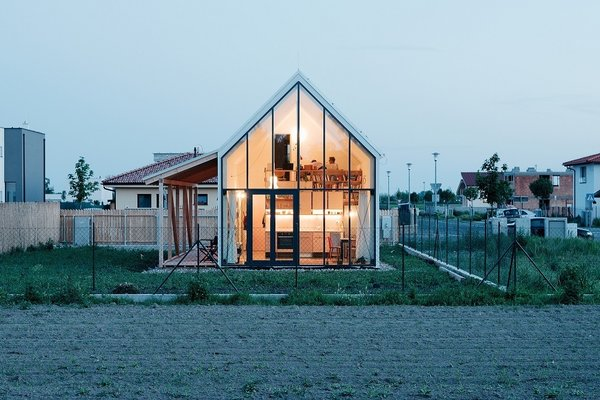 The north wall of the IST home functions as a cut-away, offering a peek inside an efficient yet cozy dwelling. Architect Peter Jurkovič built the home for a woman who had sold her flat in the big city of Bratislava and wanted something that reminded her of the village life of her childhood.
