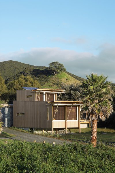 The cedar-clad home designed by Herbst Architects faces the Pacific Ocean, tucked behind sand dunes from the sparsely populated Medlands Beach.
