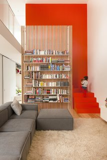 11 Modern Stairways That Do Way More Than Just Connect Floors - Photo 11 of 11 - In the city's Villeray neighborhood, a cramped structure is recast as an open work-play space for a young family. The stairs are practically hidden behind a slatted ash screen that supports steel bookshelves.