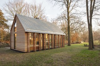 This Light-Filled Cabin in the Netherlands Is Completely Made by Hand - Photo 9 of 9 - Building atop the foundation of a previous greenhouse was a cost-cutting measure; it allowed the project to be considered a renovation and thereby qualify for a temporary tax reduction. Its traditional, gabled form also pays homage to the original structure.