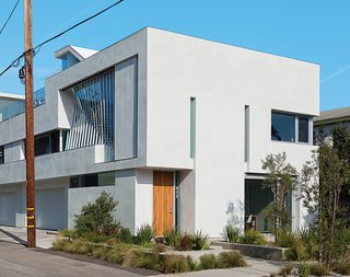 "A Minimalist Duplex in Venice, California - Photo 1 of 9 - The glass staircase figures prominently in the facade, but Don designed the windows to ensure privacy. Using computer models, he conducted visual studies to suss out sight lines from the street. ""People can't see in, but we still get light."""