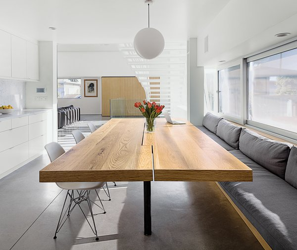 Don designed and built the white-oak kitchen table, which is cantilevered so knees don't bump the underpinnings.