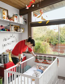 "Baby Max's bedroom (in his parents' Los Angeles A. Quincy Jones house) is outfitted with a Gulliver crib and a red PS cabinet, both from Ikea, as well as a Birds in Harmony mobile by Christel Sadde and Katsumi Komagata for the Museum of Modern Art Store. The custom ""I brake for unicorns"" neon sign is from Let There Be Neon, a shop in New York City."