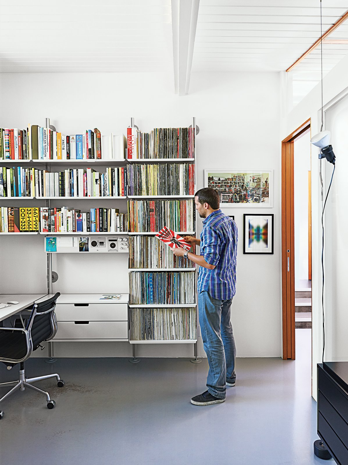"""""""It's like Lego for grown-ups,"""" Fissmer says of Rams's 606 Universal Shelving System for Vitsœ, which makes another appearance in the office. """"It's a responsible way to handle storage.""""  Photo 9 of 10 in A Midcentury Home Keeps the History Alive"""