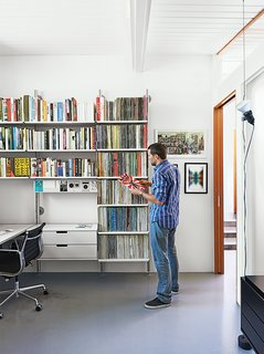 """A Midcentury Home Keeps the History Alive - Photo 9 of 10 - """"It's like Lego for grown-ups,"""" Fissmer says of Rams's 606 Universal Shelving System for Vitsœ, which makes another appearance in the office. """"It's a responsible way to handle storage."""""""