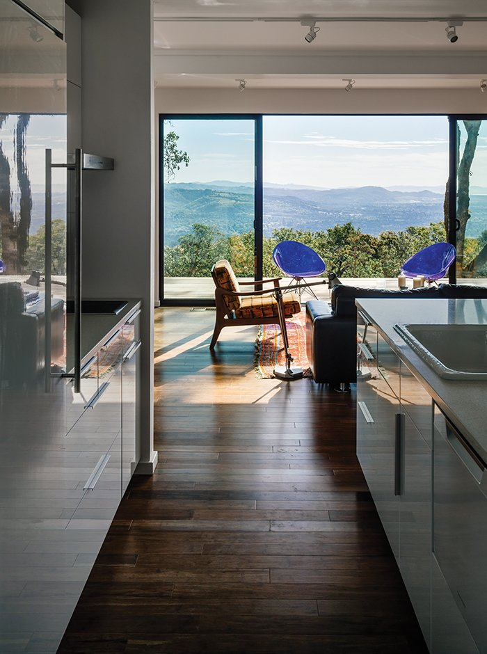 """Stott and Levy used Teragren bamboo flooring and Milgard sliding glass doors. """"Universal design isn't just for older people,"""" the daughter says about the single-story layout and zero-step entries. """"If you don't need steps, don't have them.""""  Photo 5 of 9 in This Northern California Prefab Gets a Dose of Universal Design"""