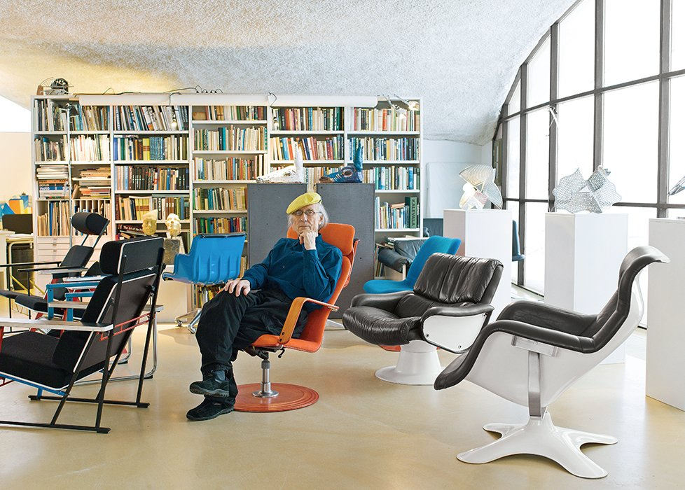 Yrjö Kukkapuro reclines in his 1976 Fysio chair in the open sitting area of his live-work home outside Helsinki—a perfect time capsule of the Pop art–influenced 1960s. He is surrounded by products from his six-decade career, including a molded fiberglass-and-leather Karuselli lounge chair, designed in 1964 and soon to be reintroduced by Artek.