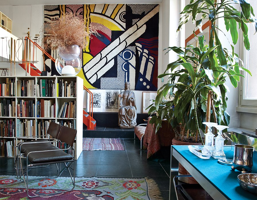 A limited-edition Roy Lichtenstein carpet dominates one wall of designer and architect Gae Aulenti's living room in Milan. She lived in this Brera apartment, mostly furnished with her own designs, such as her 1964 April folding chairs for Zanotta—from 1974 until her death in October 2012.
