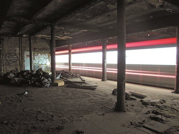 Beneath the Streets<br><br>A train passes through an abandoned station in the New York City subway. Photo courtesy Jurne.