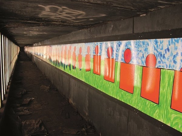 Masstransiscope—a 228-panel installation by artist Bill Brand—can be viewed from trains headed towards the Manhattan Bridge. It was installed in 1980 and sanctioned by the MTA. Photo courtesy Jurne