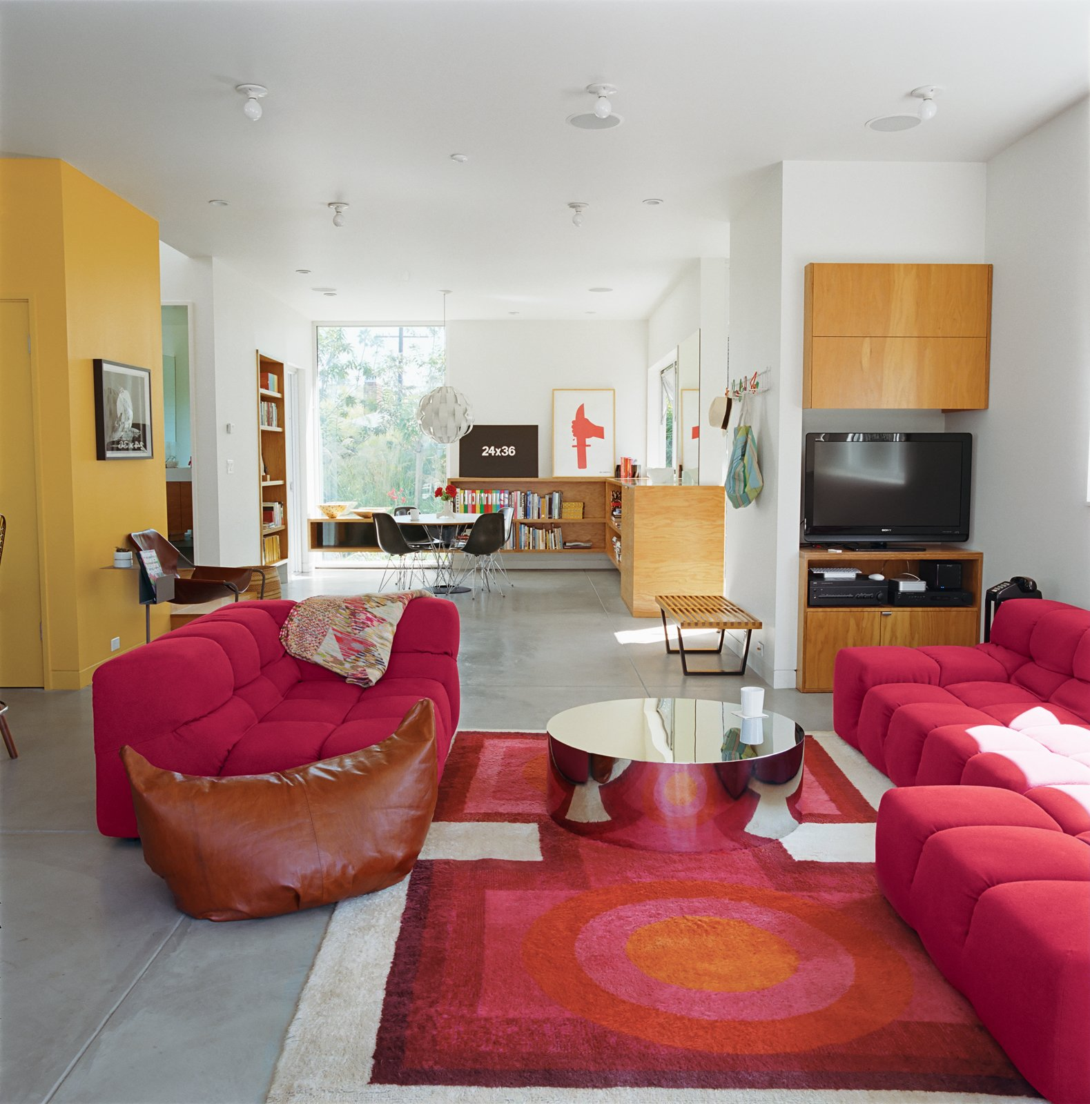 Grunbaum was unafraid of a little color, as his living room (above) proves. It includes a coffee table by Mockett and a Tufty-Time sofa by Patricia Urquiola for B&B Italia.  Photo 2 of 11 in Daft Punk Could Play at This House