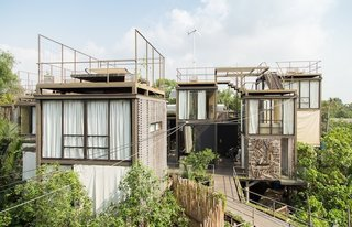 15 Modern Summer Rentals - Photo 1 of 15 - Walden Amidst the Thai Treetops (Bangkok, Thailand)<br><br>A team of Thai architects and designers took Thoreau's natural guidebook as gospel when creating this eco-friendly tree house, which sits on stilts made from reclaimed wood and bamboo. The listing's own storytelling—imagine sitting on the daybed with a glass of wine and that special someone, listening to the wind wind through the coconut trees and wind turbine—sounds like Harlequin crossed with Mother Jones, but, cliches and eco-consciousness aside, it sounds very inviting.<br><br>Listing at Breathtaking Chao Praya River View