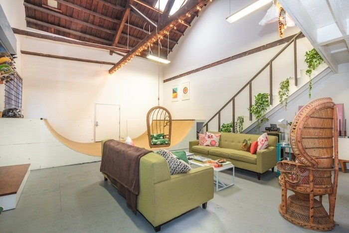 Modern Loft with Designer Halfpipe (Los Angeles, USA)  While the colorful, green-and-pink accents in this mid-century styled loft demand attention, it's hard for any furniture to overshadow the working half-pipe in the center of the 1,500-square-foot loft in Boyle Heights. While the outdoor patio and BBQ, accessible by a large roll-up door, strongly suggests grilling and evenings drinks al fresco, you may want to bring your deck just in case.  Listing at LA - Large Creative Skate Loft! 15 Modern Summer Rentals - Photo 2 of 15
