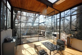 15 Modern Summer Rentals - Photo 10 of 15 - A Treeline Terrace Channelling Philip Johnson (Atlanta, Georgia)<br><br>The brainchild of a local architect and designer who financed the construction themselves, the Berne Street Treehouse, located on Atlanta's BeltLine system of parks and trails, provides a literal bird's-eye-view of the forests surrounding downtown. The upper room (pictured), bathed in sunshine from the skylight, opens to a series out outdoor terraces.<br><br>Listing at Both Floors Modern Glass Tree House