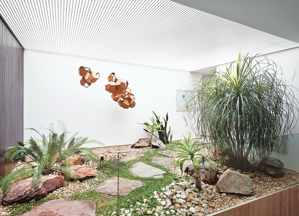 A small interior courtyard features a huge skylight and the sculpture Air-Port-City/Cloud-City/ 14-5-4 Cloud Modules 30 Net by Tomás Saraceno.