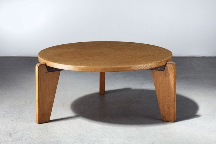 Gueridon Table (1949)  Consider this the heavy metalworker's acoustic set: Designed for Paris University, this smooth tripod table showed Prouvé stepping out of his comfort zone and experimenting with a different material: wood. Given the post-war steel shortage, it wasn't a bad time to try something new.  Image courtesy Galerie Patrick Seguin